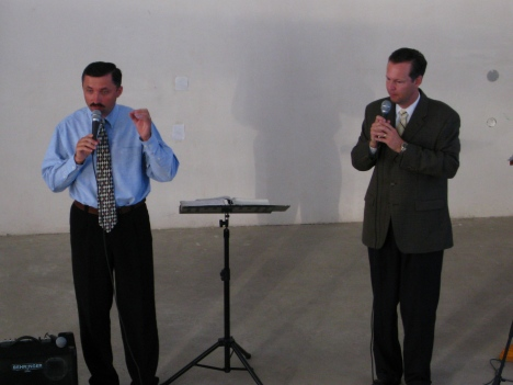 Dr. Stan Buckley is preaching the Gospel and Alexandru Sanduleac is translating